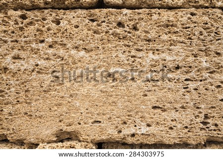 Texture yellow shell limestone closeup