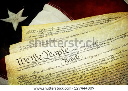 Textured American Constitution lying over top of the US flag. - stock photo