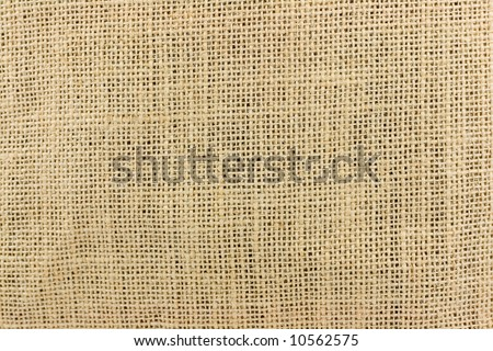 Textured background of a sandy brown burlap - stock photo