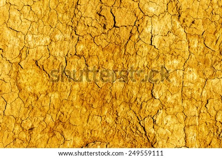 Textured background of dry cracked earth surface. drought in summer - stock photo
