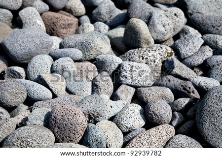 Textured background of volcanic lava rocks - stock photo