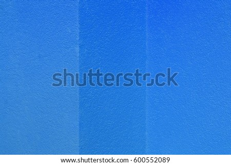 Textured blue stucco wall. Material design background