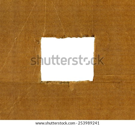 Textured cardboard frame with rough torn edges isolated over white - stock photo