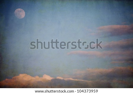 textured cloudscape background with moon - stock photo