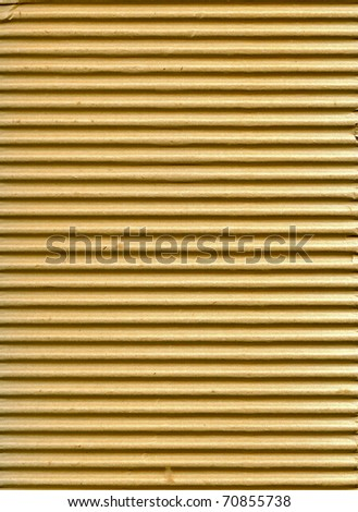 Textured corrugated striped cardboard with natural fiber parts - stock photo