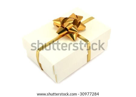Textured cream giftbox with gold ribbon and bow - stock photo