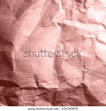 Textured crumpled red paper detail with light effect for background with copy space. - stock photo