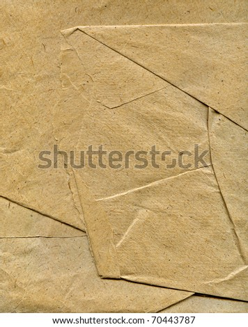 Textured crushed crumpled packaging brown paper background - stock photo