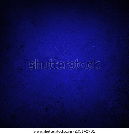 textured dark blue paper background design, spotlight center and black vignette frame, blue painted wall surface - stock photo