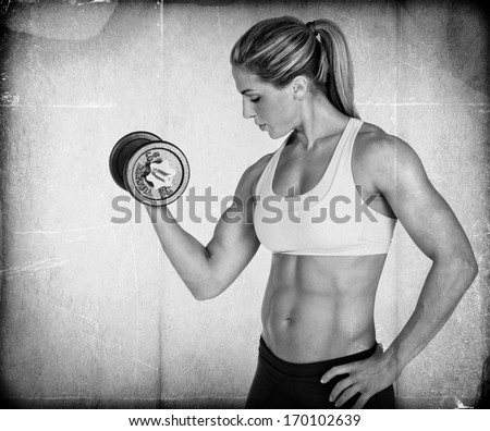 Textured Female Body Builder lifting weights - stock photo