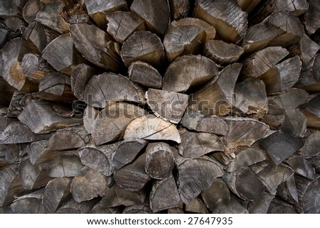 Textured firewood logs piled up