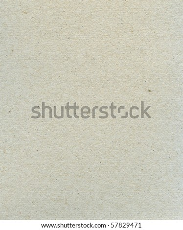 Textured grainy recycled paper with natural fiber parts - stock photo
