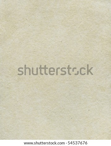 Textured grainy rough recycled paper with natural fiber parts - stock photo
