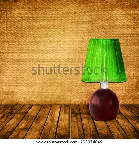 Textured grunge wallpaper and wooden panel background with Vintage green desk lamp - stock photo