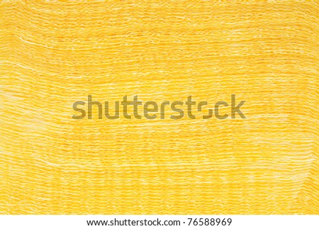 Textured heap of yellow napkins - stock photo