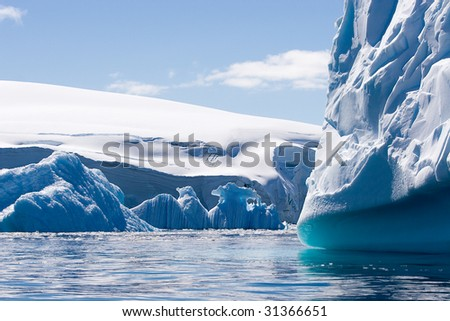textured icebergs with blue and cyan colors - stock photo