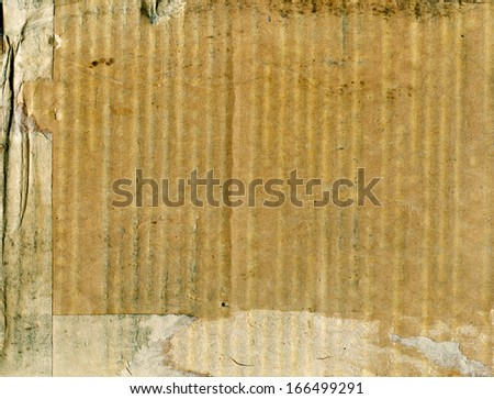 Textured obsolete cardboard with natural fiber parts background - stock photo