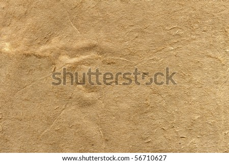 Textured obsolete recycled paper with natural fiber parts - stock photo