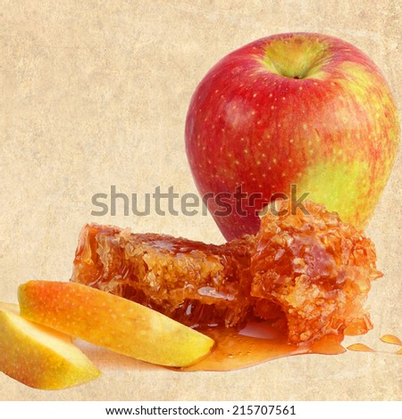 Textured old paper background with apple fruit and honey comb with honey. Vintage style image  - stock photo
