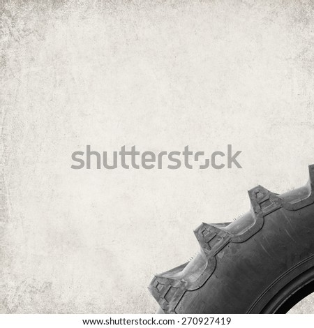 Textured old paper background with automobile truck tire - stock photo