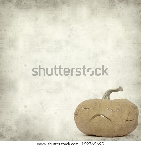 textured old paper background  with carved pumpkin