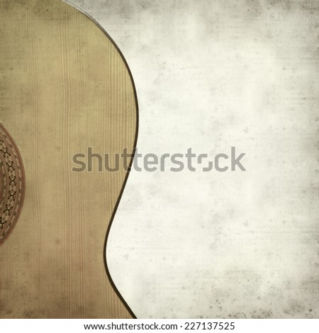 textured old paper background with classic acoustic guitar - stock photo