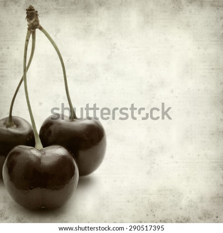 textured old paper background with dark red cherries - stock photo