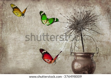 Textured old paper background with dry herb and colorful butterflies.Still life with the dry flower of wild carrots in cooper pot and colorful butterflies. Image done in vintage style - stock photo