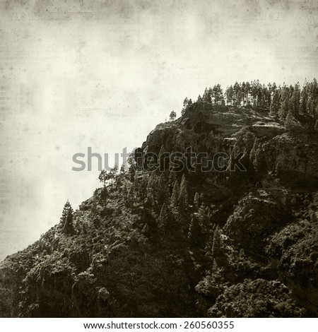 textured old paper background with Gra Canaria landscape