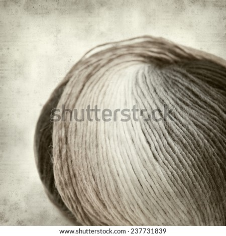 textured old paper background with knitting yarn - stock photo