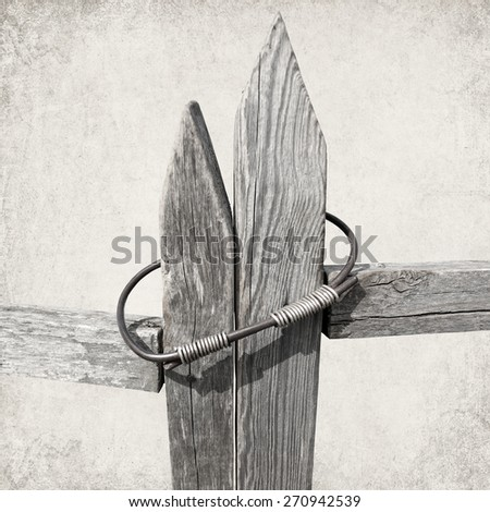 Textured old paper background with locked gate of old wooden fence