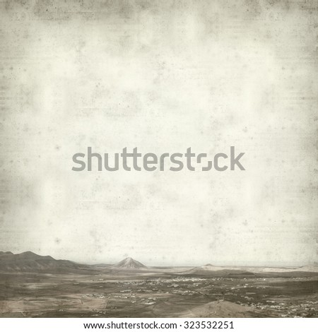 textured old paper background with Northern Fuerteventura landscape - stock photo