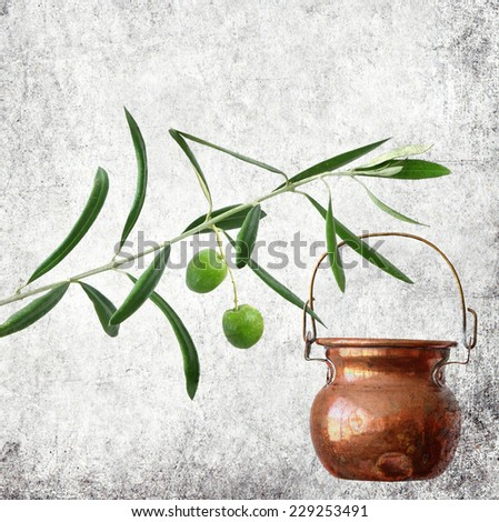 Textured old paper background with olive tree branch with fruits and copper jug for oil. Paper texture. Aged textured image in retro style  - stock photo