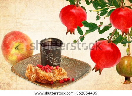 Textured old paper background with pomegranate, apple fruit and honey comb with honey - Jewish traditional food for Rosh Hashana - Jewish new year. Vintage style - stock photo