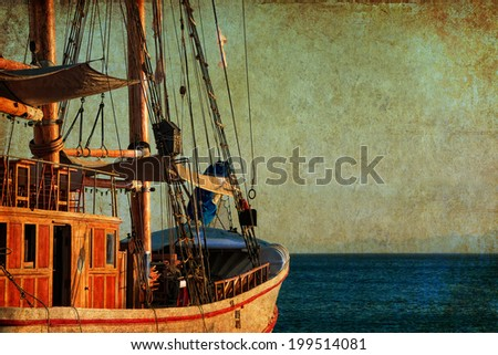 Textured old paper background with sailing ship floating by the sea. Copy space is available - stock photo