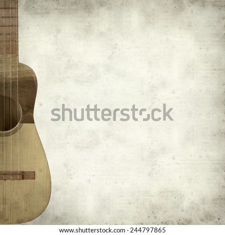 textured old paper background with timple, folk instrument from Canary Islands