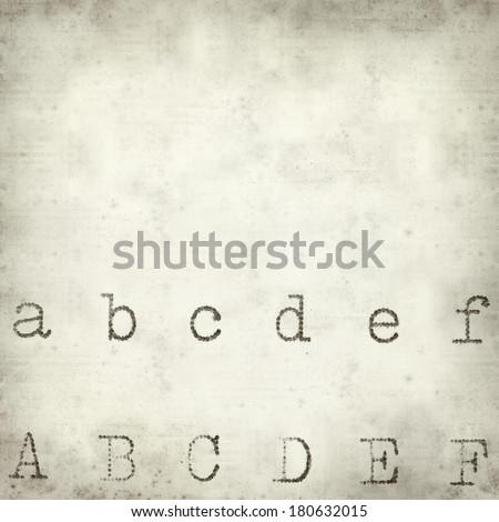 textured old paper background with typewriter test - stock photo