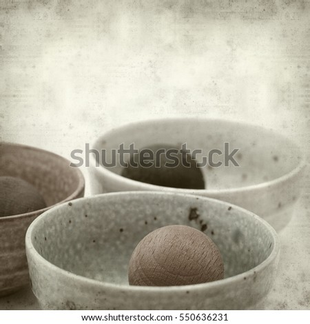 textured old paper background with wooden balls air fresheners