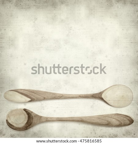 textured old paper background with wooden spoon
