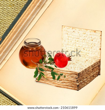 Textured old paper book background with matzoh ( matzah or matzo is bland flat dry bread), ripe pomegranate and honey - jewish traditional festive food symbols    - stock photo