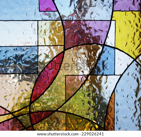 Textured paint on glass/Stained Glass - stock photo