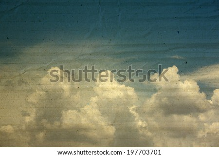textured paper box of clouds on blue sky for vintage background.