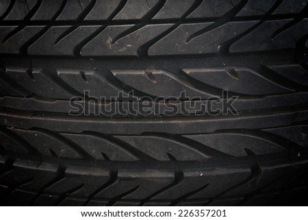 Textured pattern of a new tire background - stock photo