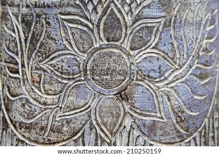Textured pattern of Thai flower carving on wood background - stock photo