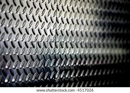 textured perforated metallic background - stock photo