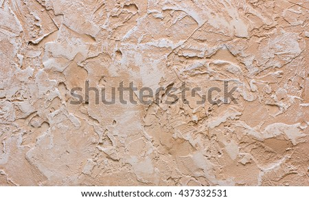 textured plaster - texture in brown and beige tones. Decorative plaster texture on the wall - art brush stroke background - stock photo