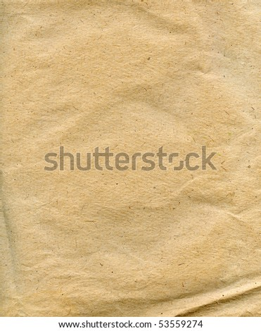 Textured recycled packaging brown paper background - stock photo