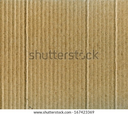 Textured recycled packing cardboard with natural fiber parts - stock photo