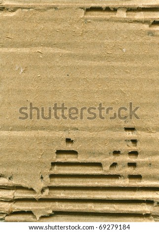 Textured recycled ribbed cardboard with natural fiber parts - stock photo
