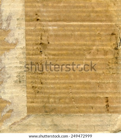 Textured recycled stained cardboard with natural fiber parts - stock photo